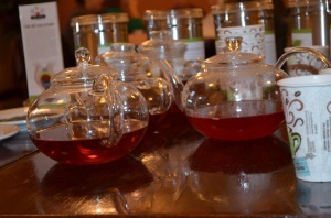 Three pots of freshly prepared He Cha Tea.